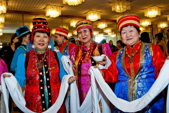 It is traditional for Buryats to greet guests with silk of white or blue.