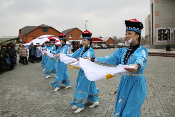 Traditional steppe greeting with white silk for an honored guest. Kalmykia. (Nikolai Boshev, Rossiskaya Gazeta)