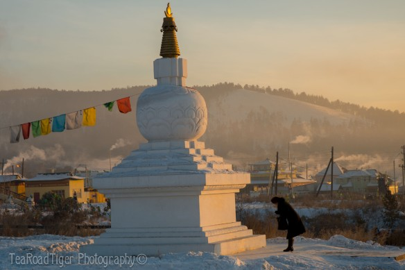 Before the White Stupa. A woman pays her respects on the first day of White Month (Sagaalgan), or the Lunar New Year at the Hamgyn Hureh Temple in Ulan-Ude, Buryatia.