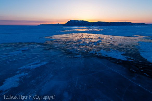 Pressing for Olkhon island after sunset on the ice. Baikal.