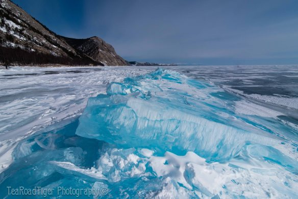 Blue ice slabs jut over a fault on Lake Baikal.