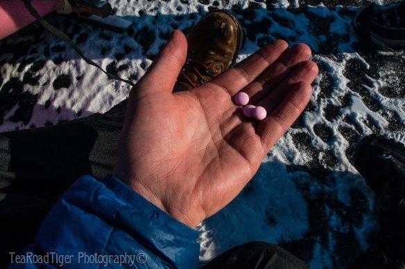 Pink ibuprofen on Baikal's ice.