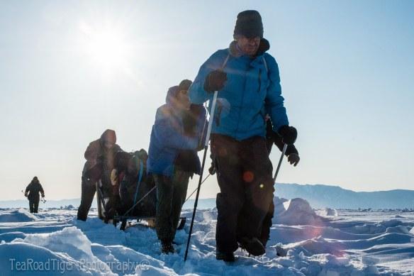 Ice sledge team crossing Baikal.