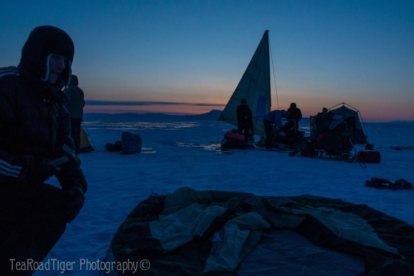Camping on Lake Baikal's ice at dusk.