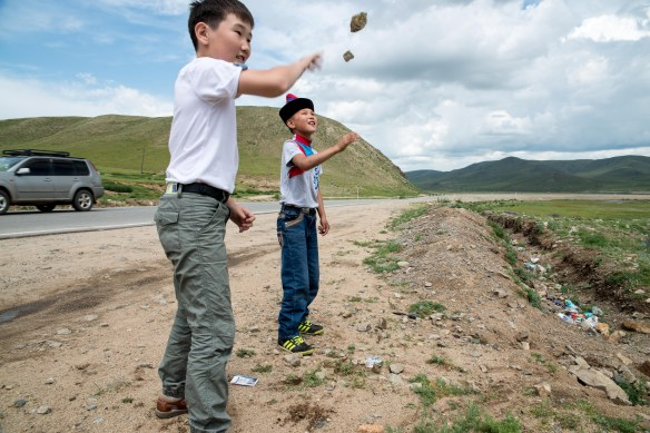 Bayasal and Saruul having fun with rocks, one of our many forms of entertainment waiting for our replacement vehicle to come from Ulaanbaatar.