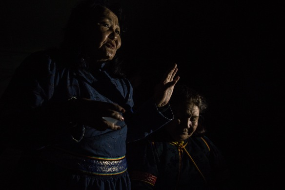 Celebratory toasts and song light up the darkness of the Khentii steppe.