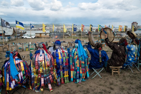 White and black shamans in prayer overlooking Ulan-Ude.