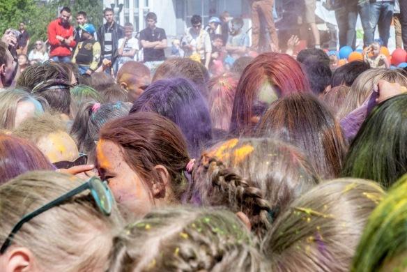 A purple haze rises off humans celebrating.