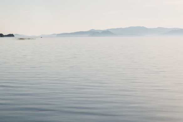 A fisherman works the waters on the horizon in Muhur Bay, on the Sacred Sea.